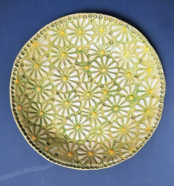 Daisies platter by Elena Bozhko Marshall $265.00 Medium: Raku clay, stains, glaze Dimensions: 35cm Diameter Year: 2021